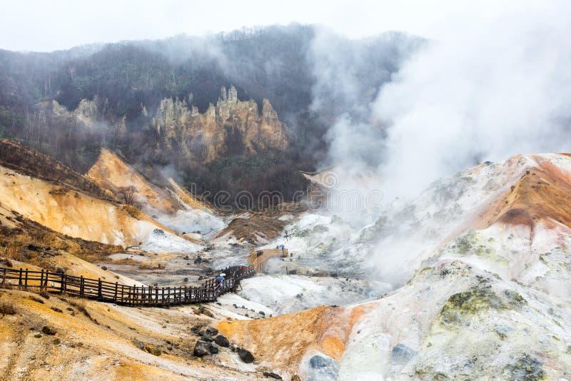 Jigokudani hell valley in Noboribetsu. Jigokudani hell valley footpath and dense sulfur gas during raining, Noboribetsu Hokkaido, Japan. Famous natural travel royalty free stock photos
