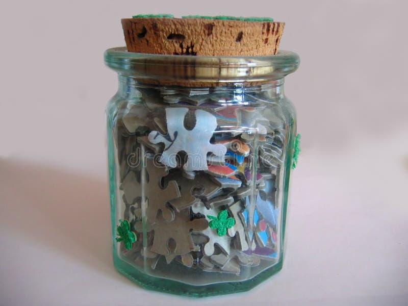 Jigsaw in a bottle stock photos