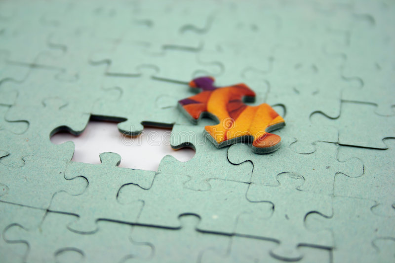 Jigsaw - Color Bit (Shallow DOF). Close up of a Jigsaw with elements missing royalty free stock photography