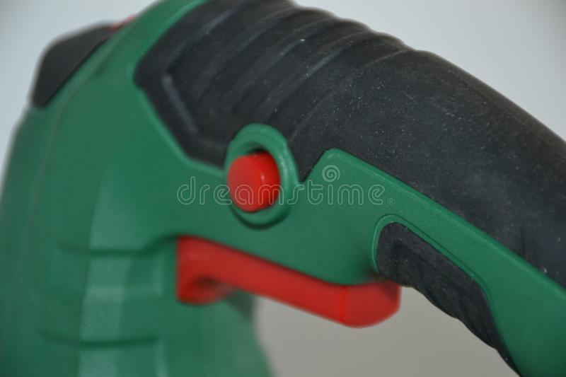 Jigsaw for cutting wood, plywood and plastic. Convenient male tool for housework stock photo