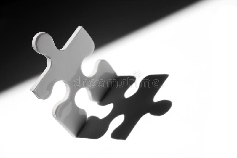 Jigsaw man stock photography