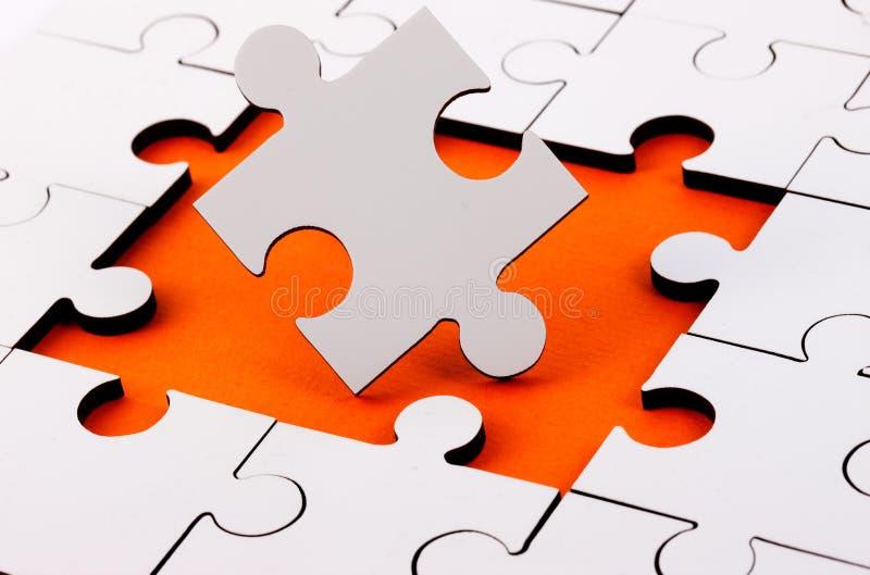 Jigsaw med styckmiss royaltyfria foton