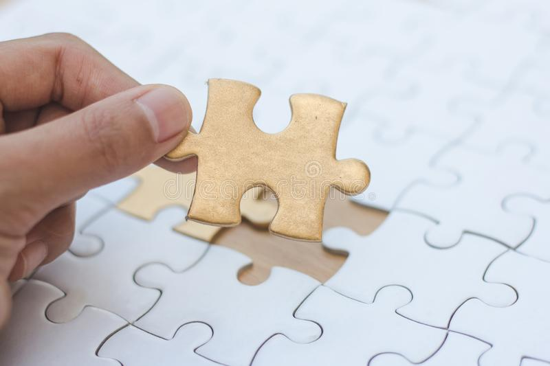 Jigsaw with one piece missing revealing,Comparative concept.  royalty free stock photos
