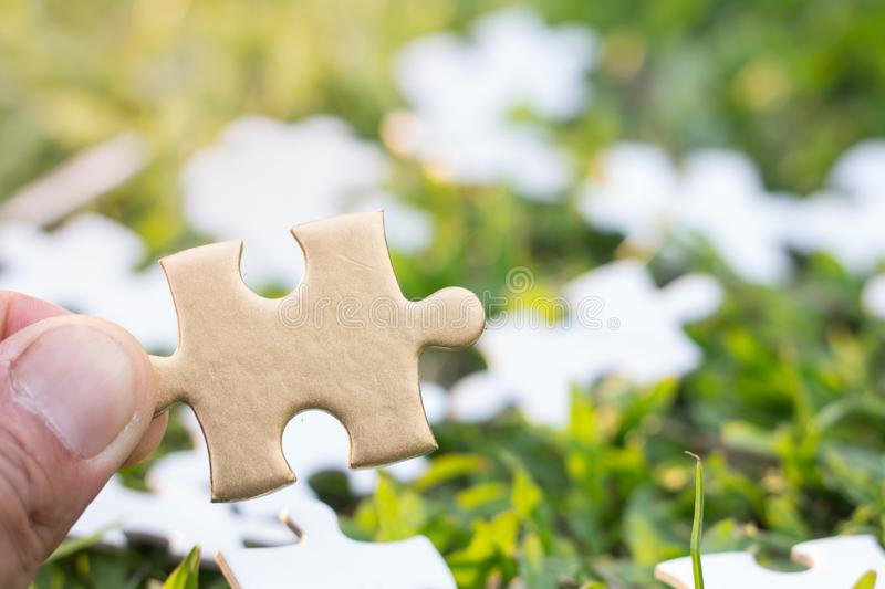 Jigsaw with one piece missing revealing,Comparative concept.  royalty free stock photography