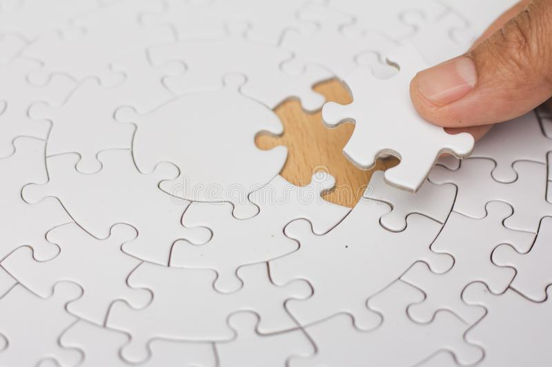 Jigsaw with one piece missing revealing,Comparative concept.  stock photos