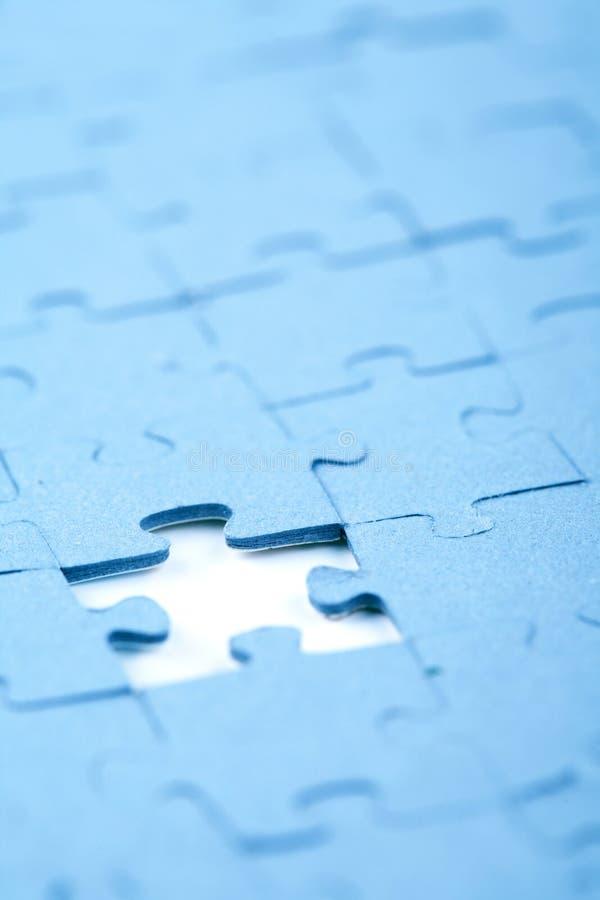 Jigsaw piece stock photos