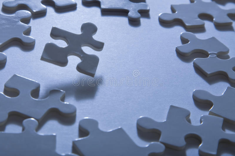 Jigsaw Pieces with Dramatic Light royalty free stock photography