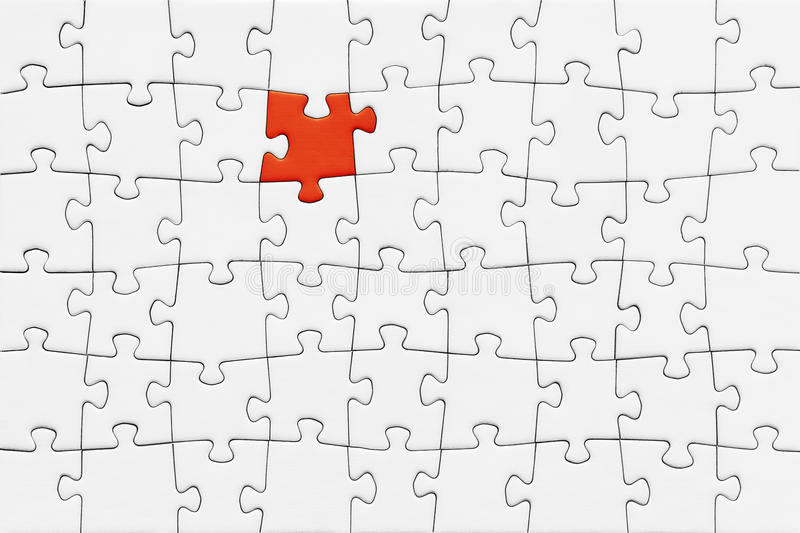 Jigsaw Puzzle. With blank white pieces and one red piece royalty free stock image