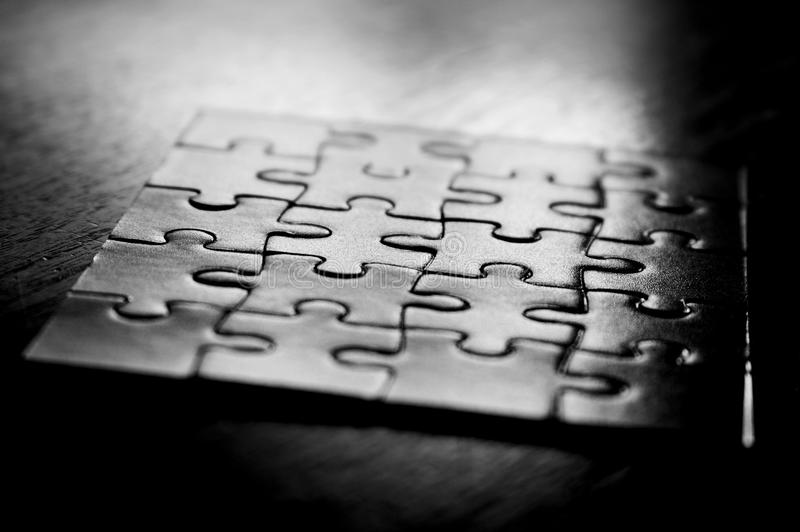 A jigsaw puzzle game. In black and white stock image