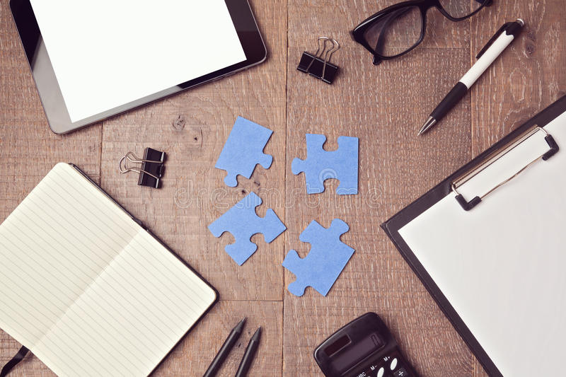Jigsaw puzzle on office desk. Team collaboration concept stock images