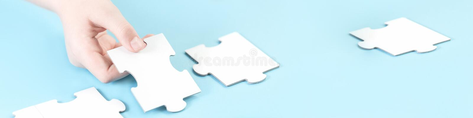 Jigsaw puzzle piece in a hand stock photo