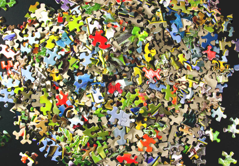 Jigsaw Puzzle Pieces. A large jigsaw puzzle with many geometric pieces royalty free stock images