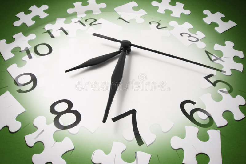 Jigsaw Puzzle Pieces and Clock royalty free stock image