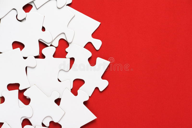 Jigsaw Puzzle on Red royalty free stock images