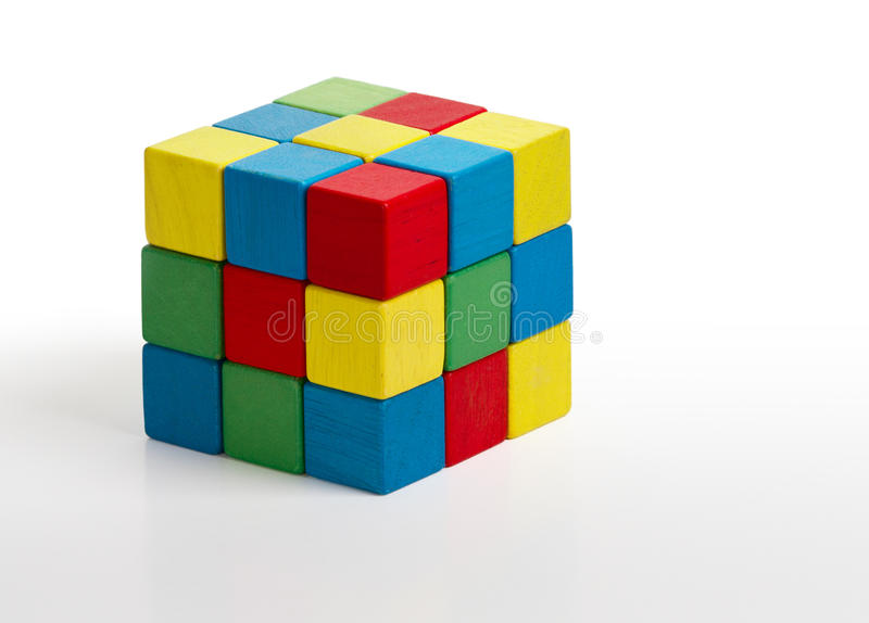 Jigsaw puzzle rubik cube toy, multicolor wooden colorful game pi. Eces over white background stock photos