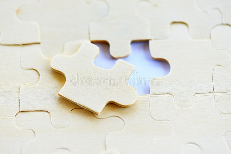 Jigsaw puzzle on white background top view - jigsaw piece connecting business solutions success and strategy concept stock photography