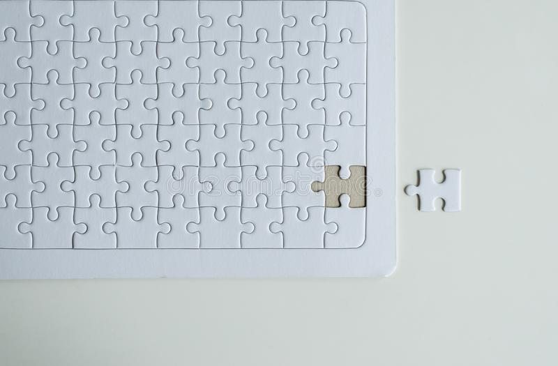 Jigsaw puzzle white color,Puzzle pieces grid,Close up,Top view copy space for text stock photography
