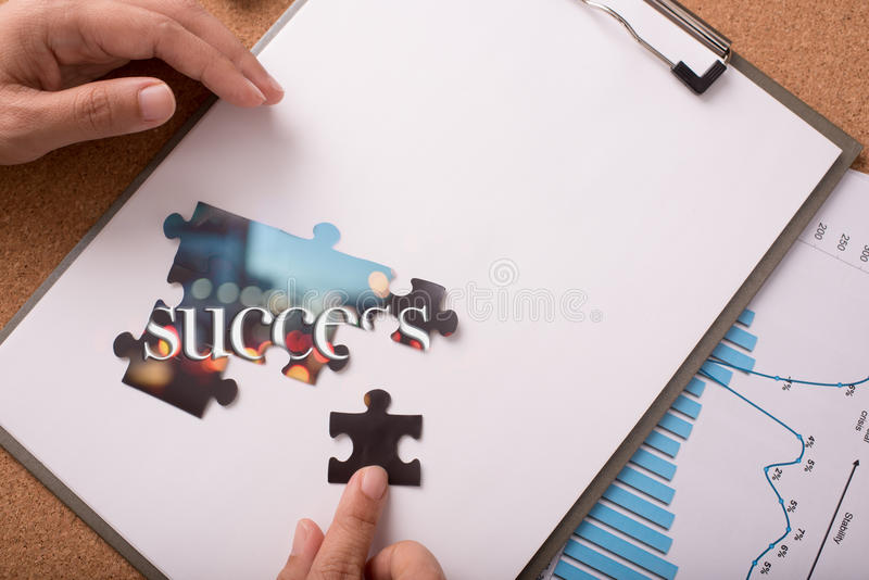 Jigsaw puzzle with word success stock image