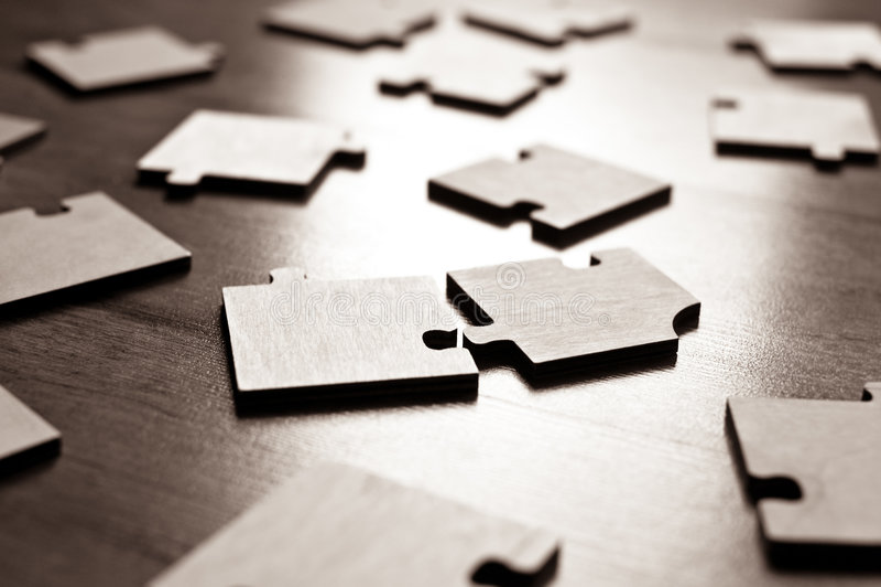 Jigsaw puzzles closeup. Closeup of many jigsaw puzzles on floor royalty free stock photography