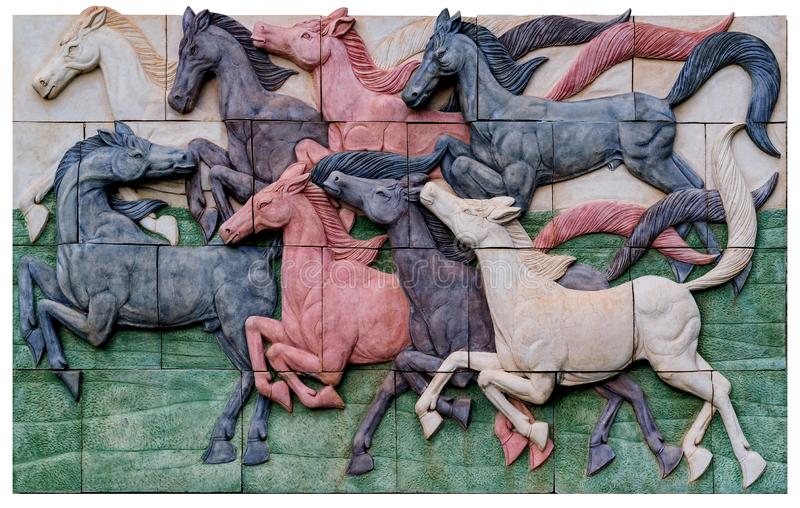 Jigsaw puzzles, horse statues on the wall.  royalty free stock photos