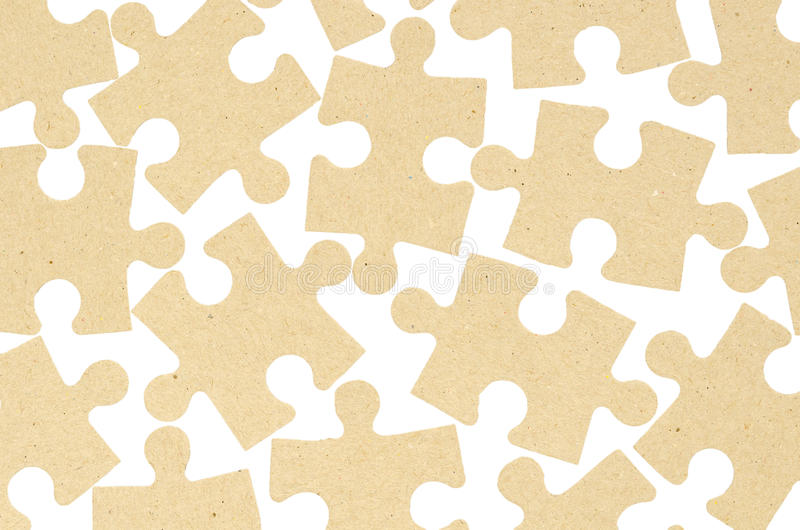 Jigsaw puzzles made of cardboard. Isolated. On white background. Concept of thinking and relaxation stock images