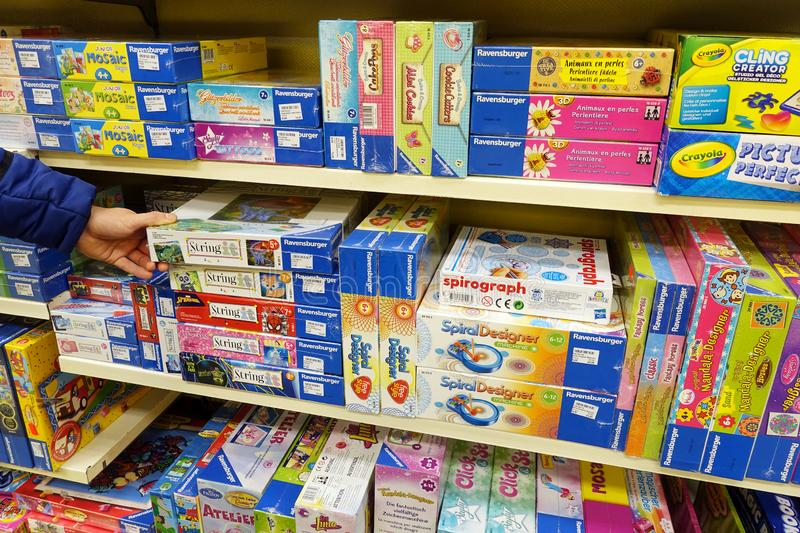 Jigsaw puzzles in a store. GERMANY - OCTOBER, 2018: Boxes of Ravensburger jigsaw puzzles in a toy store Ravensburger AG is a German game and toy company and royalty free stock image