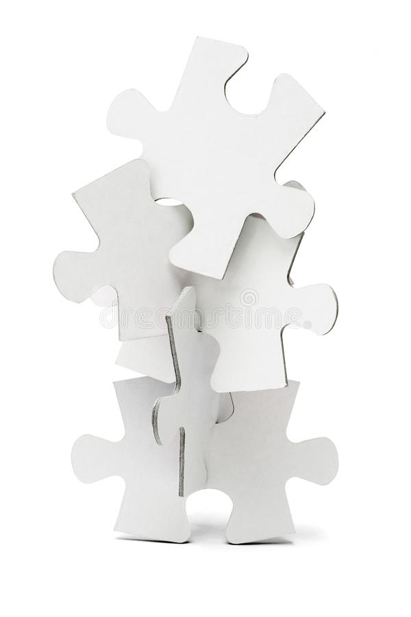 Jigsaw puzzles tower. Pieces of jigsaw puzzles arranged to form a vertical tower royalty free stock images