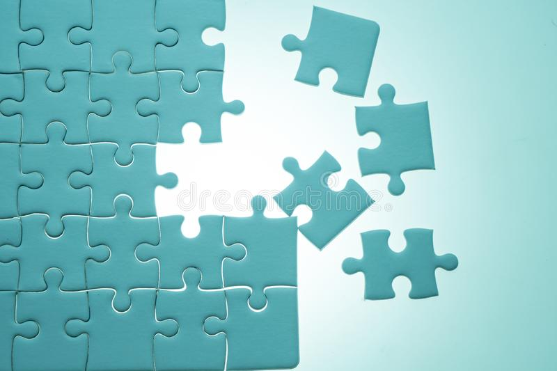 Jigsaw puzzles with white lighting and copy space. Business for connection and teamwork concept royalty free stock photography