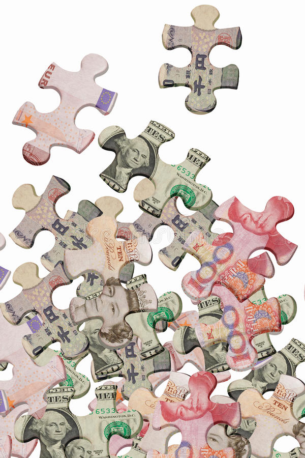 Jigsaw puzzles and world major currencies. Jigsaw puzzles superimposed with world major currencies scattered on white background stock photography