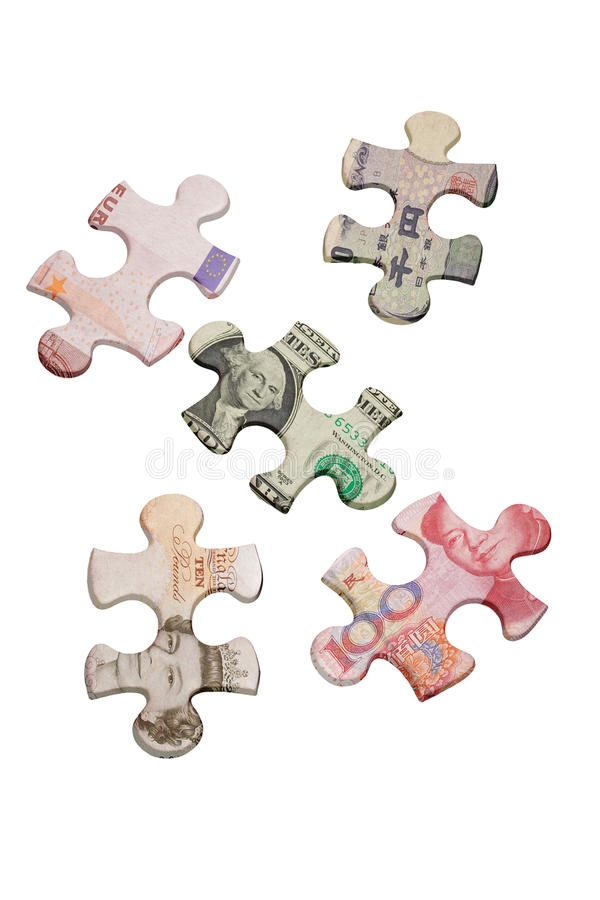 Jigsaw puzzles and world major currencies. Jigsaw puzzles superimposed with world major currencies stock photo