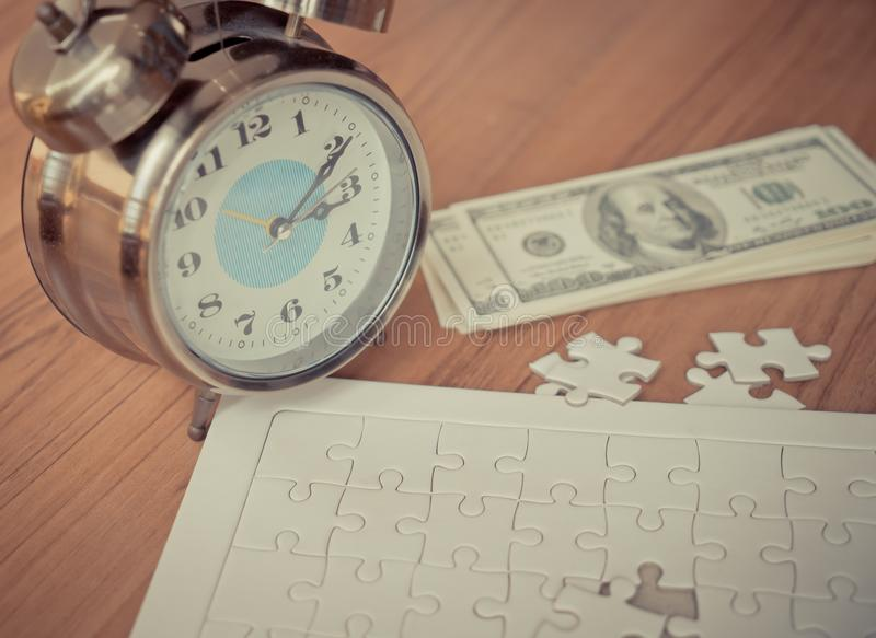Jigsaws last step time counting down for financial solution royalty free stock photography