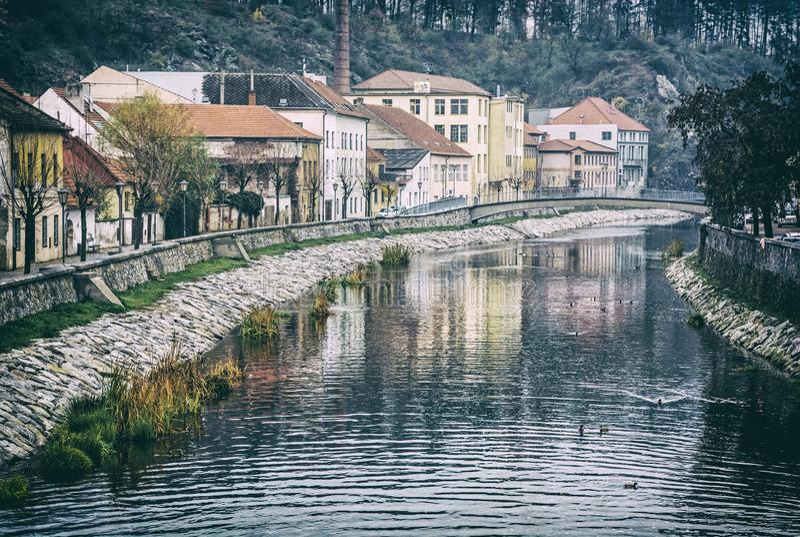 Jihlava river, Trebic, Czech, analog filter. Old buildings are reflected in Jihlava river, Trebic, Czech republic. Travel destination. Architectural theme stock images