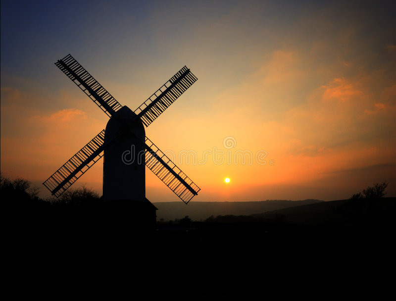 Jill Windmill in Sussex. Jill Windmill on the South Downs above Clayton in West Sussex with the sun setting in the background stock image