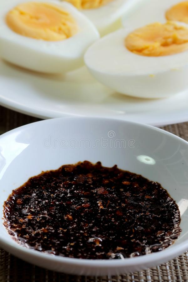 Jim-Jaew, tradition Thai spicy sauce served with sticky rice and boiled egg. Easy and delicious food sold in restaurant and street market, popular for local royalty free stock photo