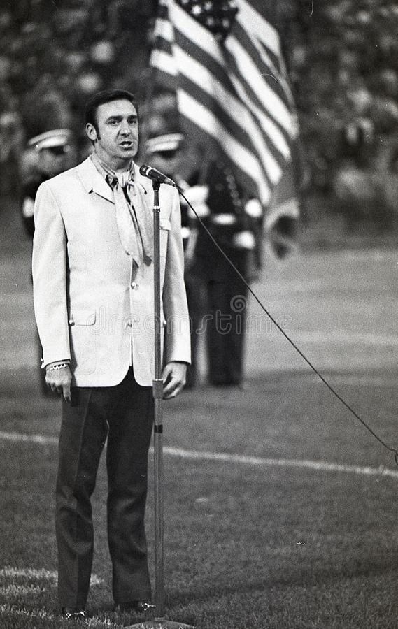 Jim Nabors sings the National Anthem. Image taken from a B&W negative royalty free stock image