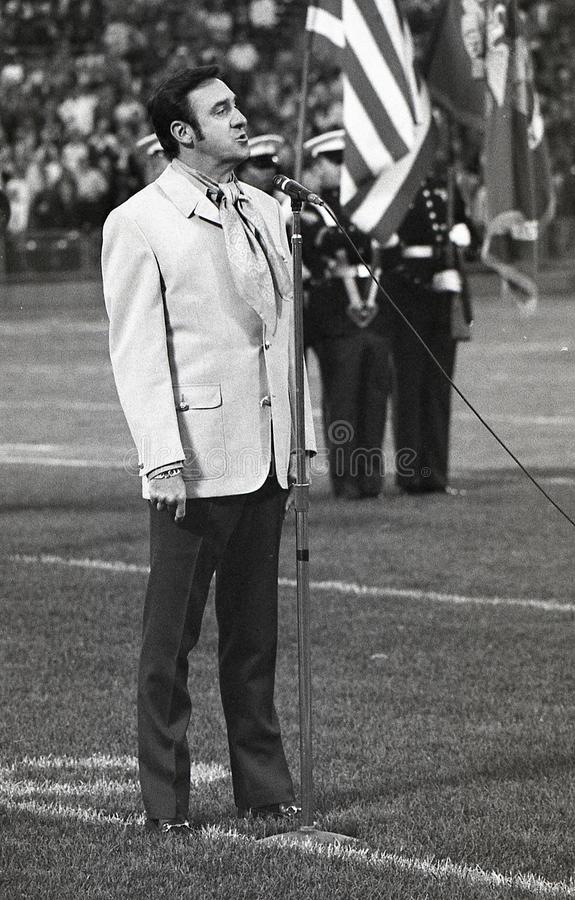 Jim Nabors sings the National Anthem. Image taken from a B&W negative royalty free stock photos