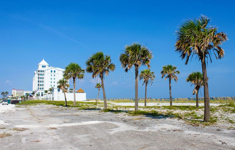 Jimmy Buffets Margartiaville Hotel on Pensacola Beach with palm trees in the foreground Pensacola Florida USA July 4 2010. View of Jimmy Buffets Margartiaville royalty free stock photo