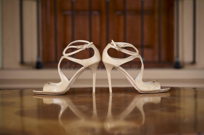 Jimmy choo high heels, bridal shoes. Over shiny floor in mexican hacienda prior to wedding celebration in Mexico royalty free stock photography