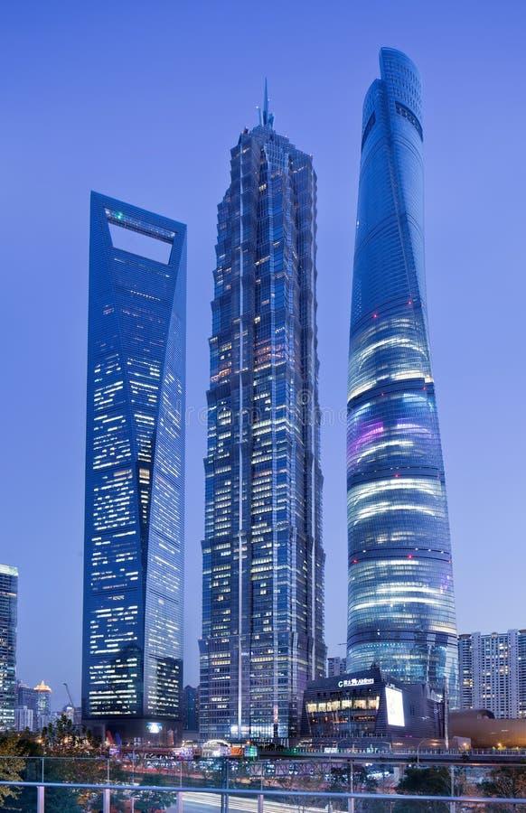 Jin Mao, Shanghai Tower and Shanghai World Financial Center at twilight. SHANGHAI-DEC. 1, 2014. Jin Mao, Shanghai Tower and Shanghai World Financial Center at stock photography