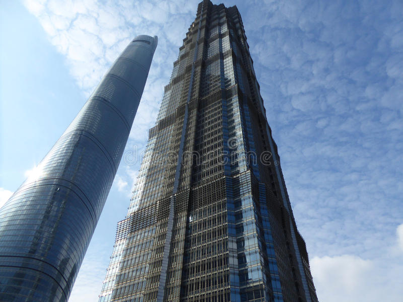 Jin mao and shanghai towers in lujiazui shanghai china. Shanghai and Jinmao towers against blue sky with white clouds in Lujiazui financial center Pudong new royalty free stock photos