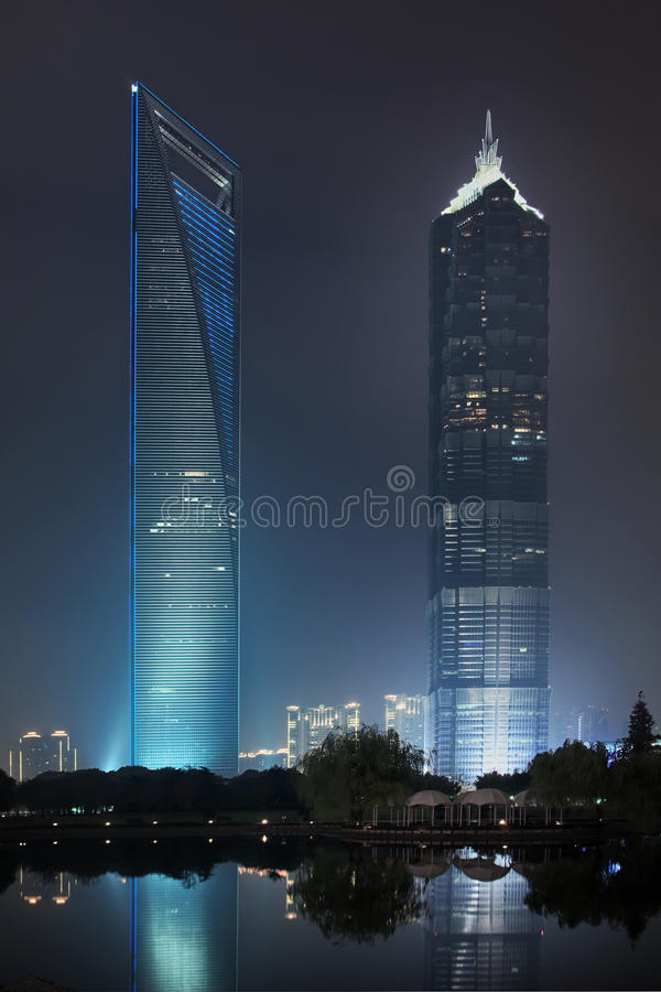 Jin Mao and Shanghai World Financial Centre at night. SHANGHAI – NOV. 21, 2010. The Shanghai World Financial Center 492m and Jin Mao Tower 421m at stock photography