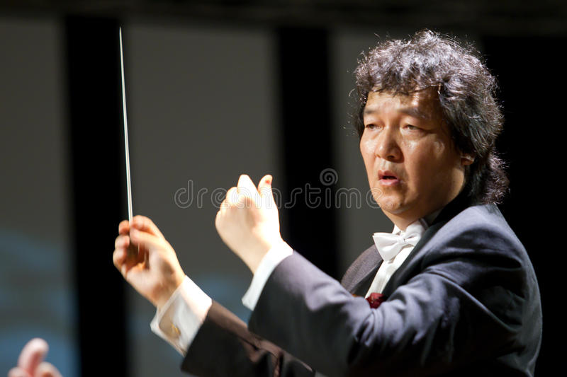 Jin Wang. Is one of the leading conductors of contemporary world. Born in China, and began his career as a violinist, conductor and then becoming collaborating royalty free stock image