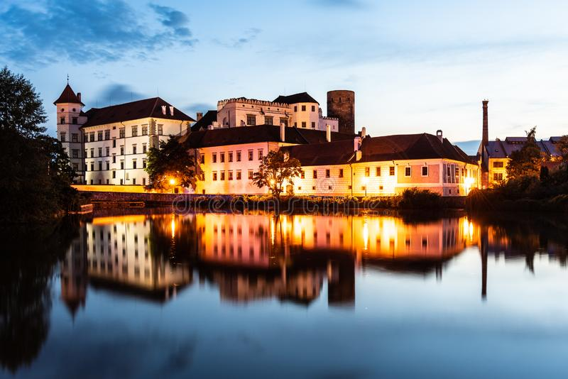 Jindrichuv Hradec Castle by night. Reflection in the water. Czech Republic.  royalty free stock photo