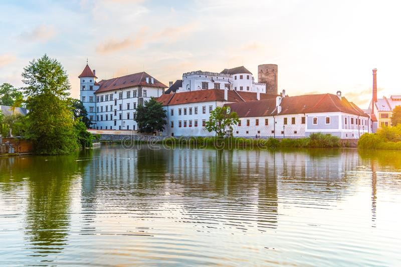 Jindrichuv Hradec Castle at sunset time. Reflected in the Little Vajgar pond, Jindrichuv Hradec, Czech Republic.  royalty free stock images