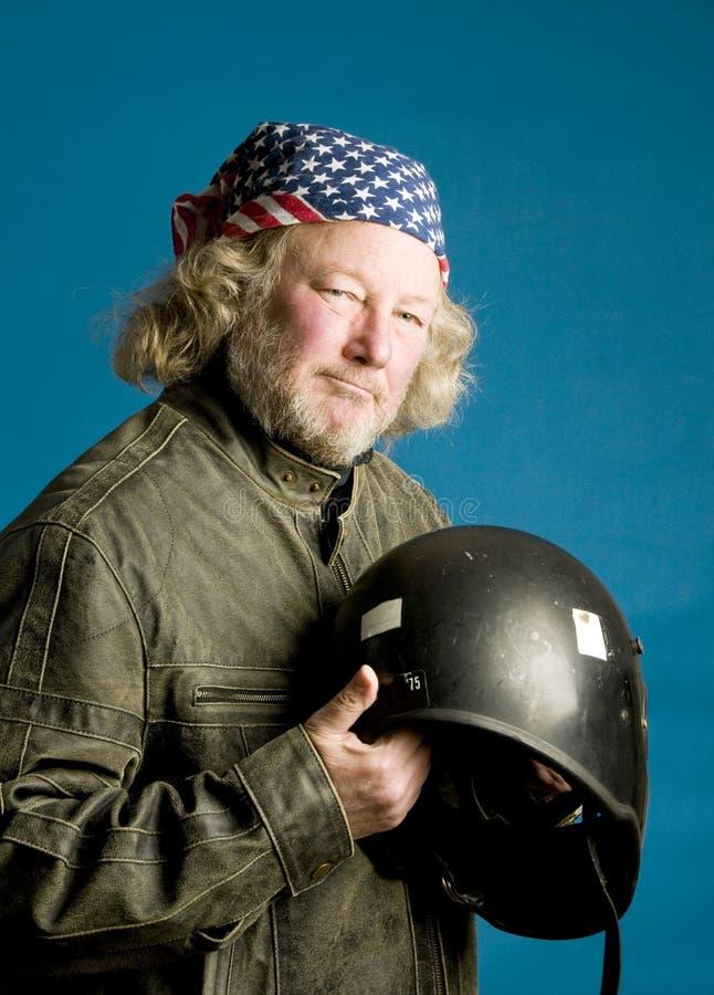 Jinete de la motocicleta con el bandana del indicador americano del casco fotos de archivo libres de regalías