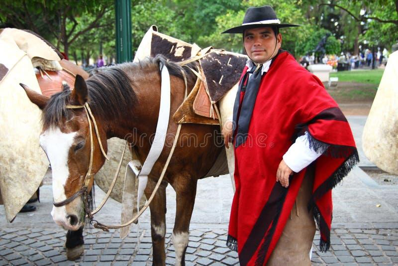 Jinetes de la Argentina en cabo rojo foto de archivo
