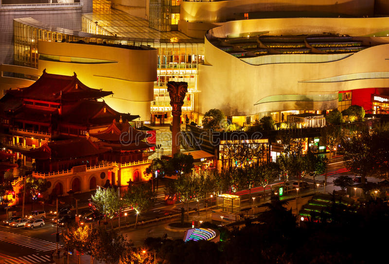 Jing An Temple Park Nanjing Street Shanghai China. Golden Temples Roof Top Jing An Tranquility Temple Park at Nanjing Street Cars and Intersection in Central stock image