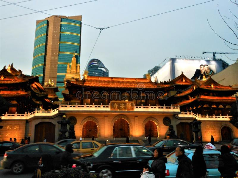 Jing An Temple in Shanghai city, China. Light, luxury, Buddhism and speed stock images