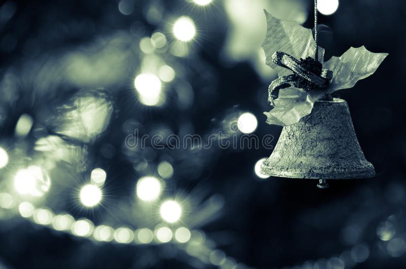 Jingle bell, Christmas tree branches. Jingle bell, Christmas tree branches with blurred background stock images
