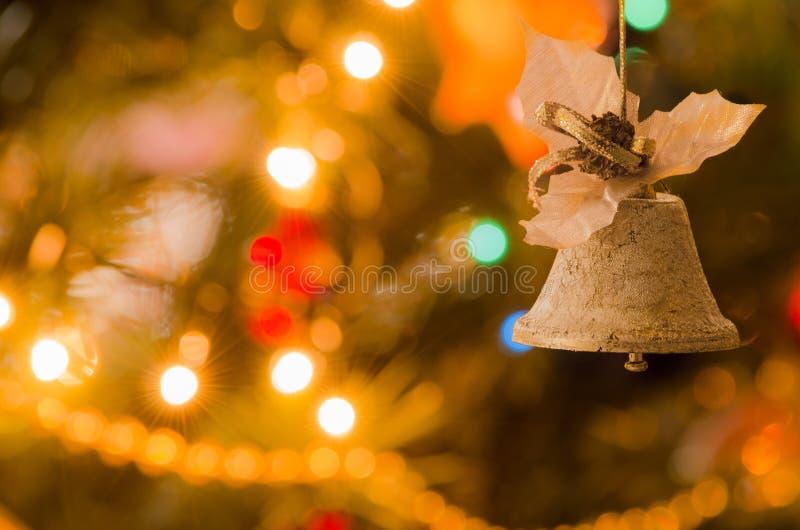 Jingle bell, Christmas tree branches. Jingle bell, Christmas tree branches with blurred background royalty free stock photography